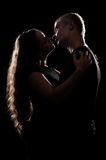 Silhouette of romantic couple over black Stock Photo