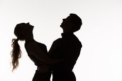 The silhouette of romantic couple Stock Photos
