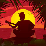 Silhouette of a romantic man playing the guitar at sunset Royalty Free Stock Images