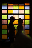 Silhouette romantic Scene of love couples on colorful wall Stock Images