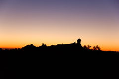 Silhouette of Roque Nublo, Gran Canaria at sunset. (Spain Stock Photo