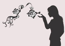 Silhouette with roses Stock Photos