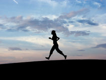 Silhouette runing. People's silhouette runing with the sky in the bottom Stock Photography