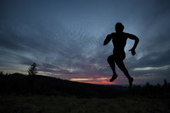 Silhouette of runner during outdoor cross-country running Stock Photo