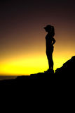 Silhouette of runner wearing a hat Royalty Free Stock Images