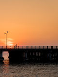 Silhouette of runners on bridge Royalty Free Stock Photos