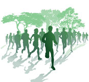 Silhouette of runners in a park Royalty Free Stock Photo
