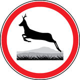 Silhouette of a running deer. Road sign Stock Images