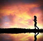 Silhouette of running girl Stock Photo
