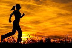 Silhouette of the running girl Stock Image