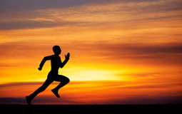 Silhouette of running man Royalty Free Stock Photos