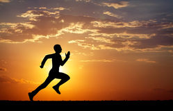 Silhouette of running man Stock Images