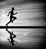 Silhouette of running man against sky. Royalty Free Stock Image