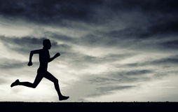 Silhouette of running man. Black and white. Royalty Free Stock Photography