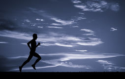 Silhouette of running man. Stock Image