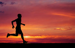 Silhouette of running man Royalty Free Stock Images