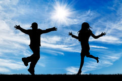 Silhouette of running to meet the man and woman stock photography