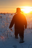 Silhouette russian man with bottle of vodka at winter sunset Royalty Free Stock Photo