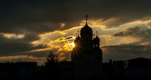 Silhouette of a Russian Orthodox Church in Barnaul, dramatic sunset with rays of light royalty free stock images