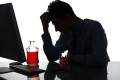 Silhouette of sad and depressed young man in alcohol addiction Royalty Free Stock Photos