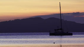Silhouette of a sail yacht stock video