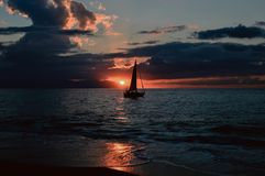 Silhouette of Sailboat on Body of Water during Sunset Stock Images