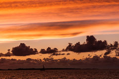 Silhouette of sailboat with fire sunset Royalty Free Stock Images