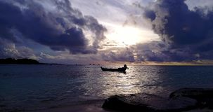 V14948 silhouette sailing boat at sunset sunrise with beautiful sky and sea on island beach. Silhouette sailing boat at sunset sunrise with beautiful sky and sea stock video footage