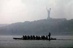 Silhouette of a sailing canoe Royalty Free Stock Images