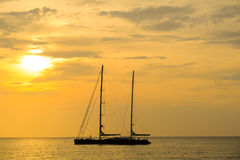 Silhouette of sailing yacht in Beautiful Sunset at andaman sea Stock Photo