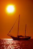 Silhouette of sailing yacht in the tropical sea at sunset.  Royalty Free Stock Photo