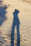 Silhouette on the sand Stock Photography