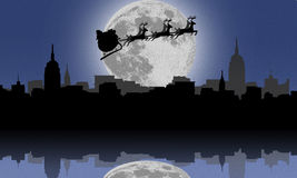 Silhouette of Santa and Christmas Reindeer above Stock Photography