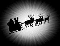 Silhouette of santa and his star Royalty Free Stock Photo