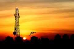 Silhouette of Satellite communication antenna with the sunset Royalty Free Stock Photography