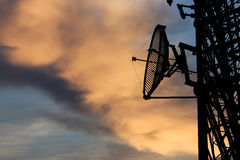 Silhouette satellite communication tower poles Royalty Free Stock Photography