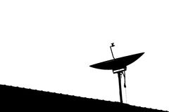 Silhouette of satellite dish on house's roof with copy space,  on white sky background Stock Photos