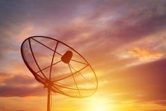 Silhouette of satellite dish on sunset background Stock Photo
