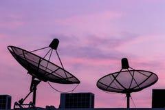 Silhouette 2 Satellite on twilight. Background Stock Image