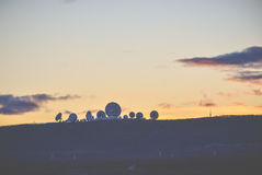 A silhouette of satellites when sun set in country side.  stock image