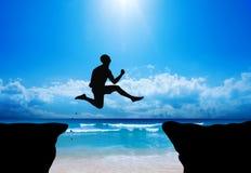Silhouette sautante Image stock
