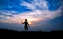 Silhouette sautante Images libres de droits
