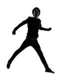 Silhouette sautante de jeune homme africain beau image libre de droits