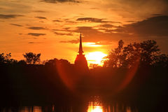 Silhouette scene of pagoda at sunset in Sukhothai Royalty Free Stock Photos