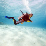 Silhouette of Scuba Diver near Sea Bottom Stock Photos