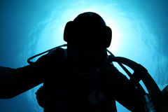 Silhouette of scuba diver Stock Photography