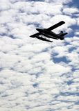 Silhouette of a sea plane. Against the clouds Stock Photography