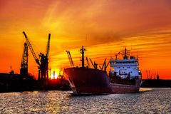 Silhouette of sea port cranes over sunset Royalty Free Stock Photo