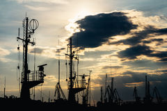 Silhouette of sea port at sunset stock photography