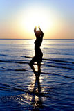 Silhouette in a sea on sunset Royalty Free Stock Photography